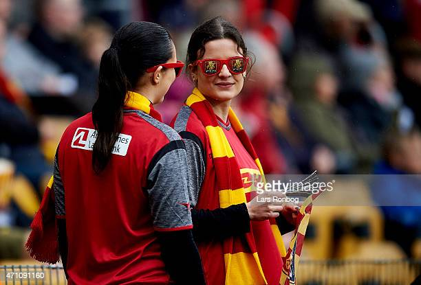 Two FÇ Nordsjallands fans looks on during the Danish Alka Superliga match between FC Nordsjalland and Silkeborg IF at Farum Park on April 25 2015 in...