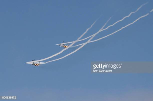 Two F15's from the 173rd Fighter Wing do a fly by before the start of the NASCAR Monster Energy Cup Series Toyota/Save Mart 350 on June 25 2017 at...