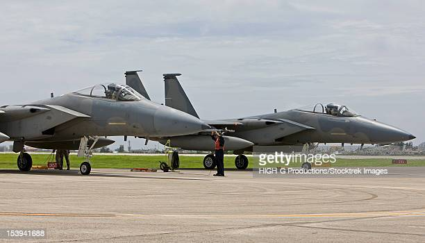 Two F-15's from the 18th Wing at Kadena Air Base, Okinawa sit at the end of runway to complete thier pre-flight checks.