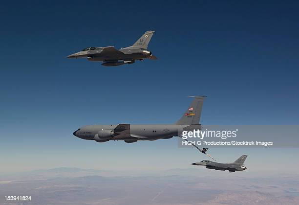 Two F-16's from the 56th Fighter Wing at Luke Air Force Base, Arizona, prepare to refuel from a KC-135 on a training mission over the Arizona desert.