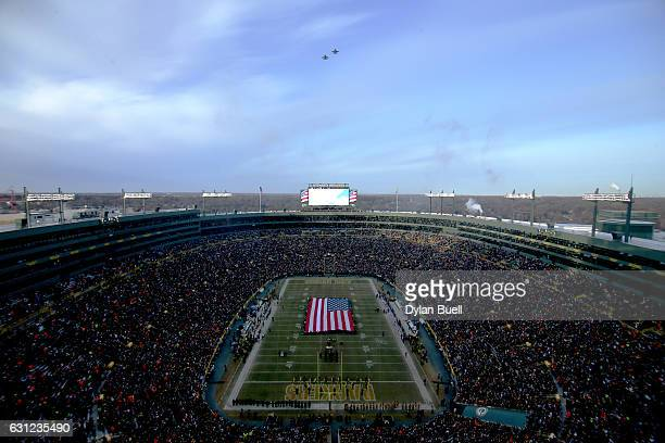 Two F18 fighter jets fly over the stadium during the national anthem before the NFC Wild Card game between the Green Bay Packers and the New York...
