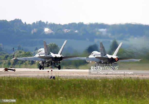 Two F-18C Hornets of the Swiss Air Force armed with AIM-120 AMRAAM missiles during exercise ELITE, Neuburg Airfield, Germany.