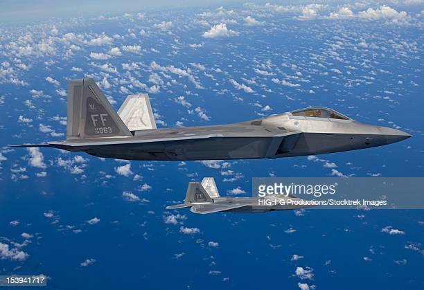 Two F-22 Raptors from the 1st Fighter Wing at Langley Air Force Base, Virginia, fly in formaton during a training mission out of Kadena Air Base, Okinawa, Japan.