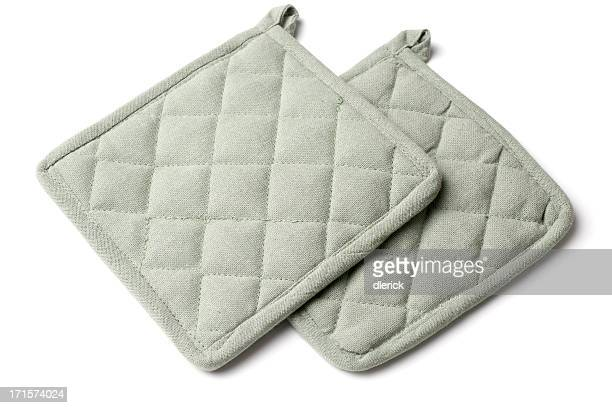 two fabric hot pan holders on white background