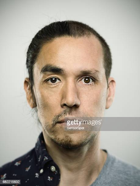 two faced man against gray background - double stock photos and pictures