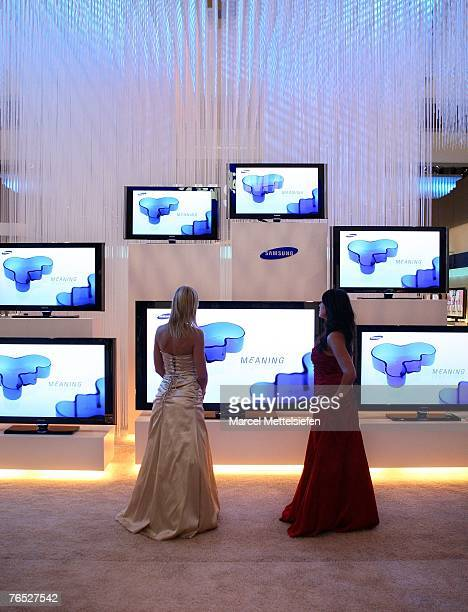 Two fair hostess look at flat screen televisions by Samsung at the IFA trade fair during the fair's last day at ICC exhibition center September 05...