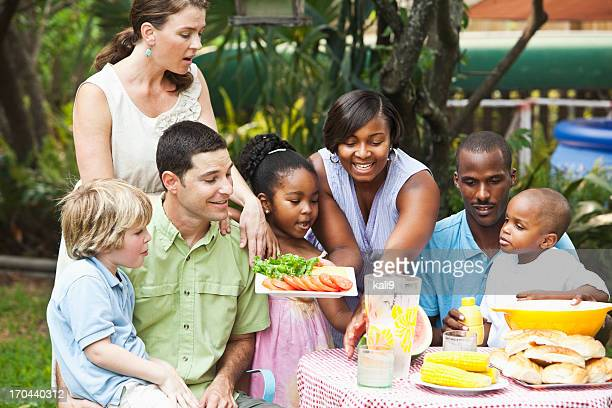 Two families at backyard cookout