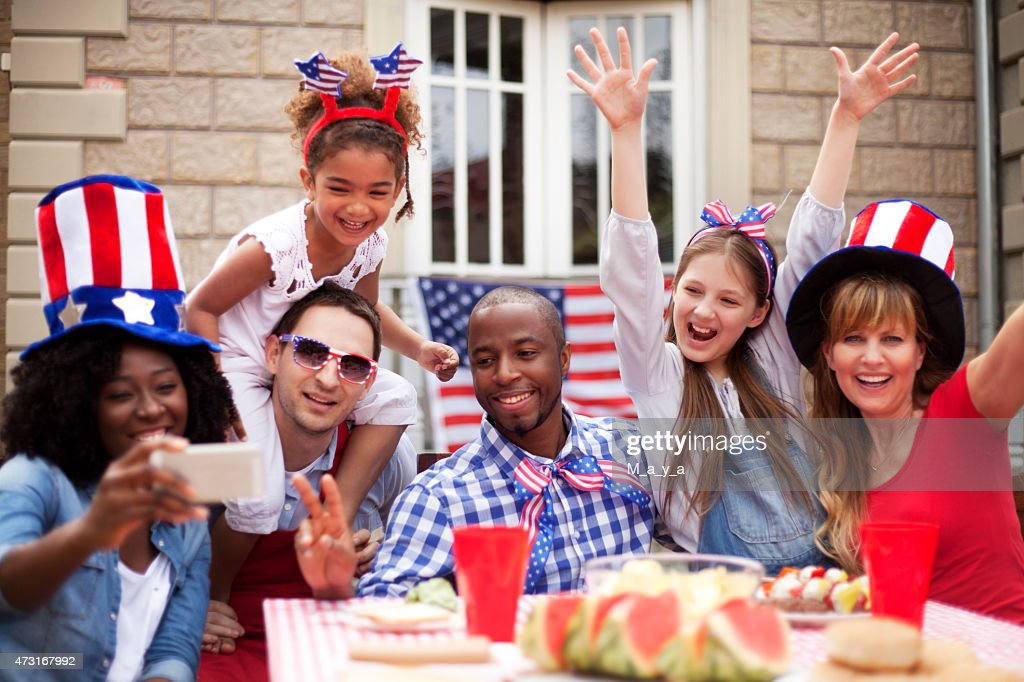 Two families happily celebrating Independence Day : Stock Photo