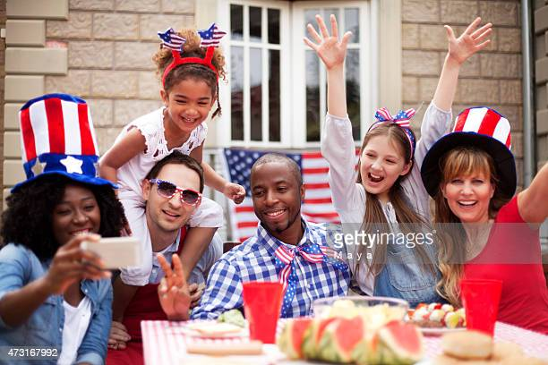 two families happily celebrating independence day - independence day stock pictures, royalty-free photos & images