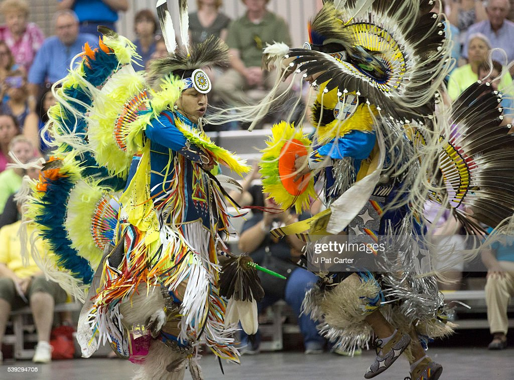 Two fancy dancers dance against each other like warriors from different tribes would have danced at the Red Earth Native American Festival, Friday, June 10, 2016 in Oklahoma City.