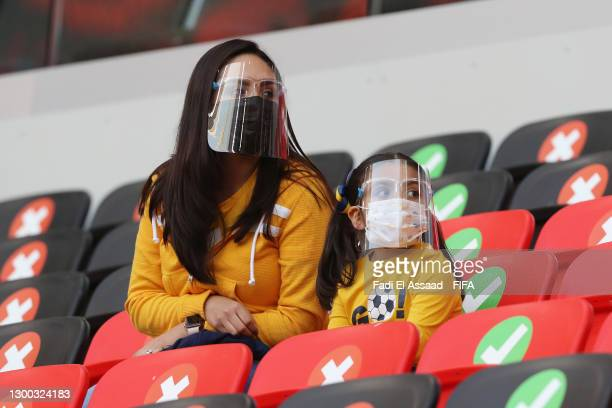 Two fans are seen inside the stadium wearing face shields and mask prior to the FIFA Club World Cup Qatar 2020 Second Round match between Tigres UANL...
