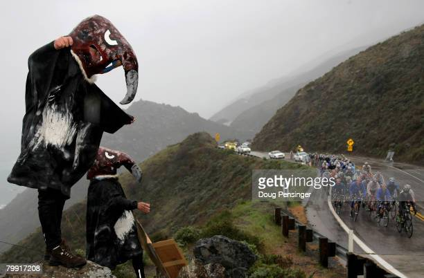 Two fans dressed as California Condors cheer on the peloton as they head down The Pacific Coast Highway on a rain soaked Stage 4 of the Amgen Tour of...