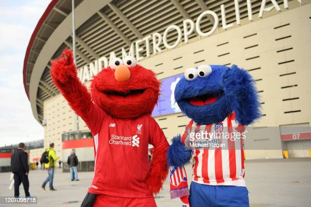 Two fans dressed up as Elmo and Blue Elmo wearing a Liverpool and Atletico Madrid tshirts pose for a photo outside the stadium prior to the UEFA...
