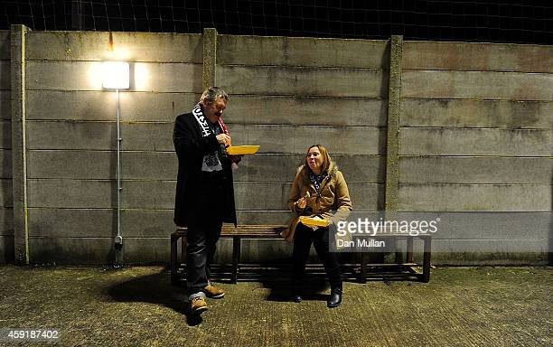 Two fans enjoy some prematch food ahead of the FA Cup First Round match between WestonSuperMare and Doncaster Rovers on November 18 2014 in...