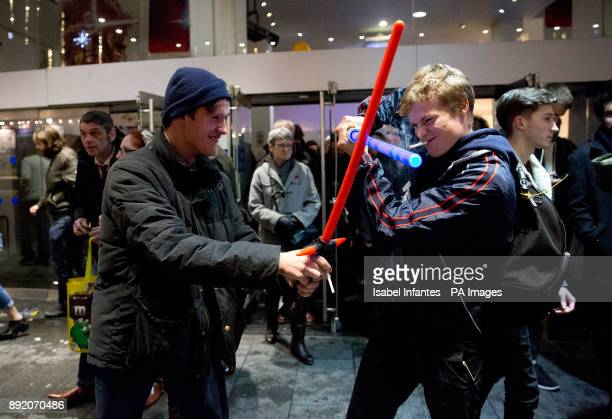Two fans fight with their lightsabers as they leave a screening of Star Wars The Last Jedi at Leicester Square in London