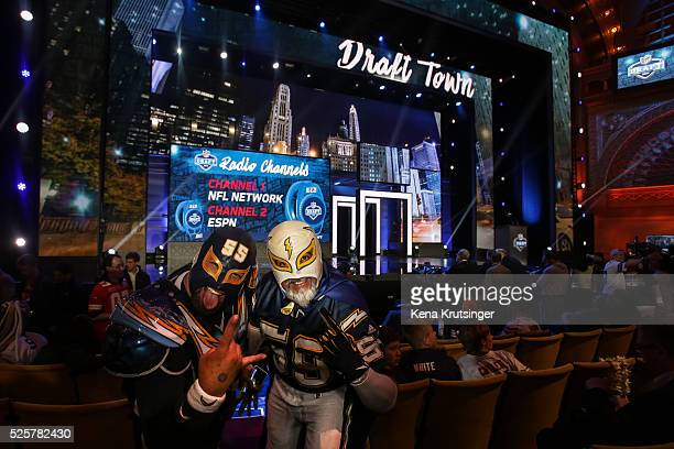 Two fans get excited during the 2016 NFL Draft at the Auditorium Theatre of Roosevelt University on April 28 2016 in Chicago Illinois