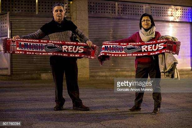 Two fans of CF Reus pose for a picture with the Match,s Scarf at Vicente Claderon stadium outdoors before the Copa del Rey Round of 32 match between...