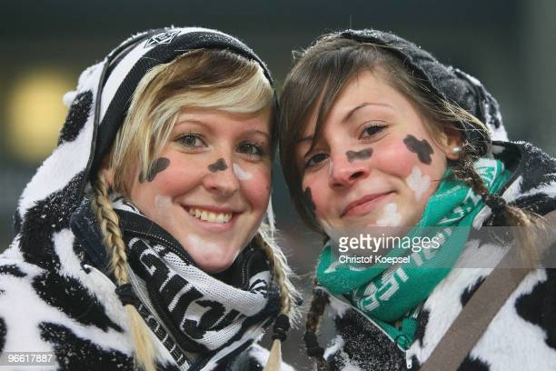 Two fans of Gladbach pose with carnival costumes during the Bundesliga match between Borussia Moenchengladbach and 1 FC Nuernberg at Borussia Park on...
