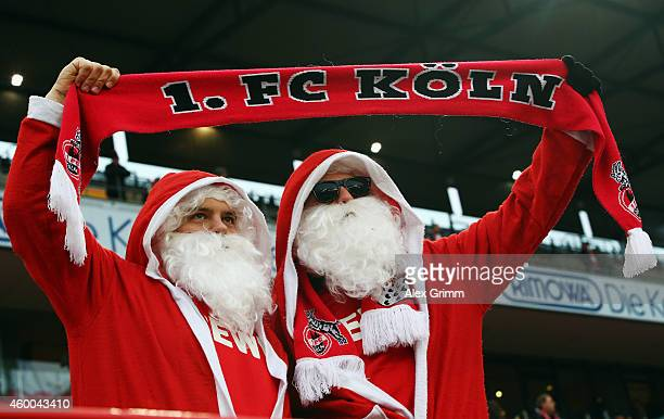 Two fans of Koeln wear Santa Claus dresses during the Bundesliga match between 1 FC Koeln and FC Augsburg at RheinEnergieStadion on December 6 2014...