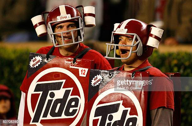 Two fans of the Alabama Crimson Tide cheer during their 327 win over the Mississippi State Bulldogs at BryantDenny Stadium on November 15 2008 in...