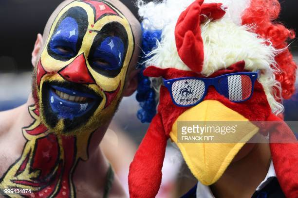TOPSHOT Two fans pose before the Russia 2018 World Cup final football match between France and Croatia at the Luzhniki Stadium in Moscow on July 15...