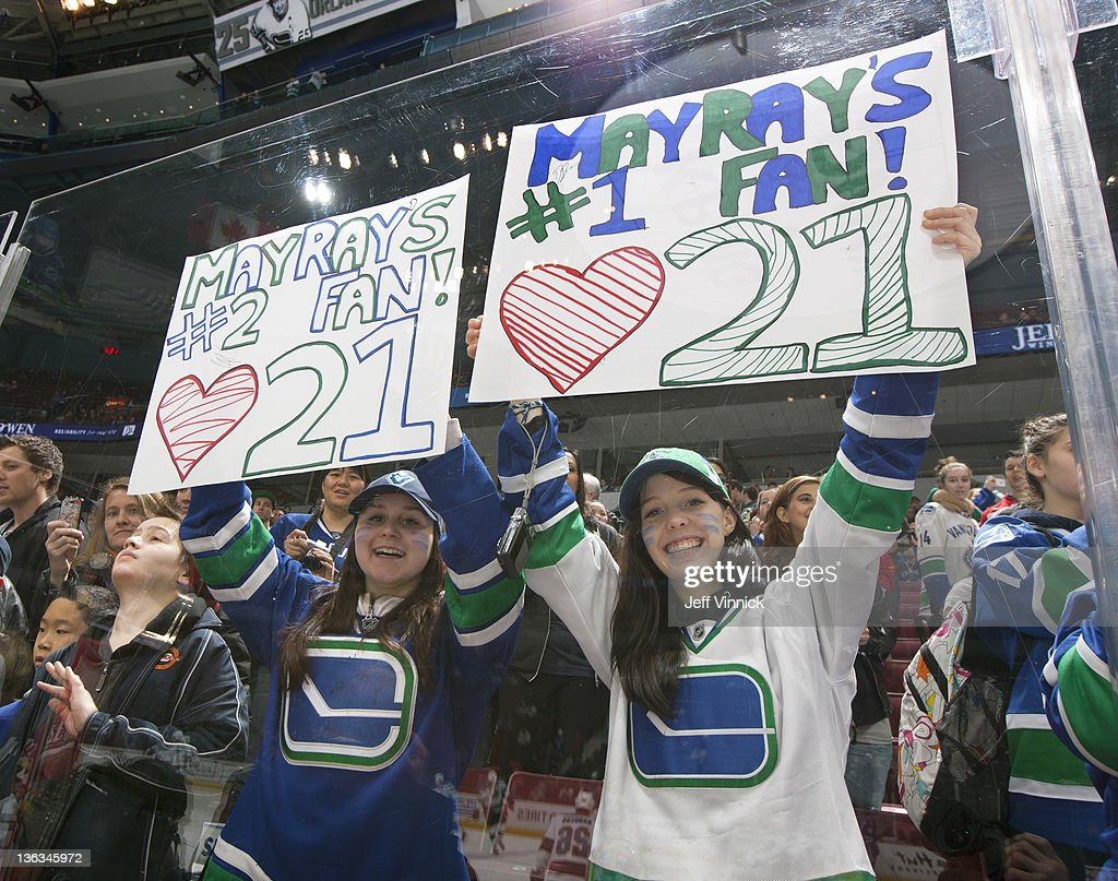 Two fans show their appreciation for Mason Raymond of the Vancouver Canucks before their NHL game against the San Jose Sharks at Rogers Arena January 2, 2012 in Vancouver, British Columbia, Canada.