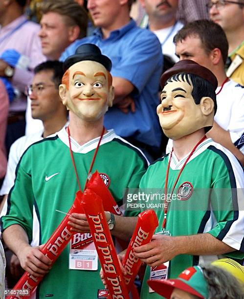 Two fans wearing masks of the famous comic actors Stan Laurel and Oliver Hardy wait for the start of the 1998 Soccer World Cup Group D first-round...