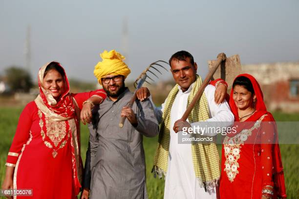 Two farmer standing portrait with their wife