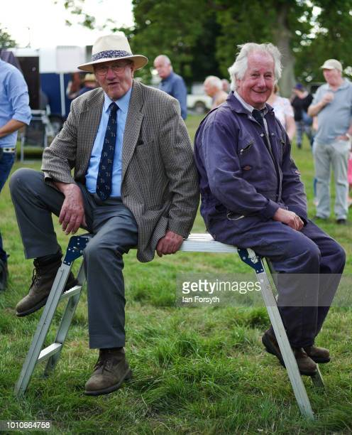 Two farmers react to the camera as they wait to enter the ring for the heavy horse judging during 152nd the Ryedale Country Show on July 31 2018 in...