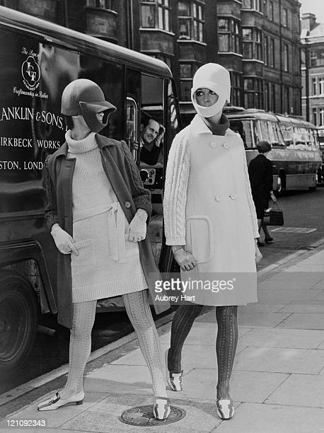 Two fashion models in knitwear and riding hat-style headgear on New Cavendish Street in London, 6th September 1966.