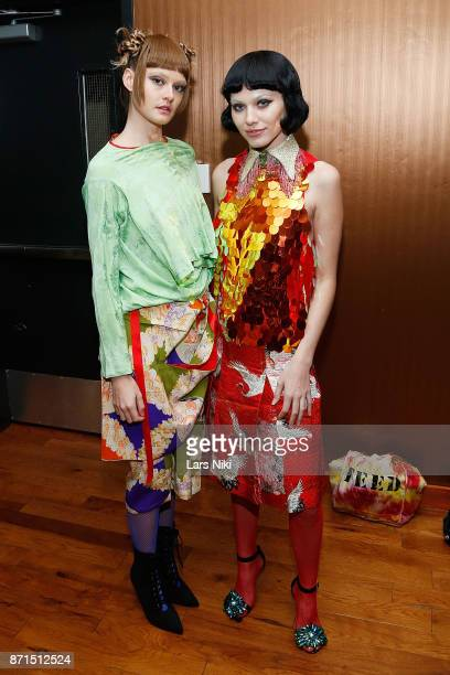 Two fashion models pose backstage during the Akiko Elizabeth Maie Fashion Show Spring Summer 2018 at Treehaus MiMA on November 7 2017 in New York City