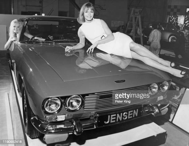 Two fashion models posing with a Jensen Interceptor Mk I Grand tourer at the Jensen stand at the Motor Show Earl's Court London 15th October 1968 The...