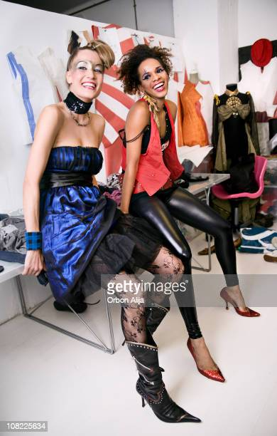two fashion models sitting backstage and smiling - latex stock photos and pictures