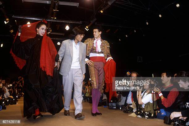 Two fashion models wear a haute couture dress and a matador's bullfighting uniform by Japanese fashion designer Kenzo Takada . They modeled the...