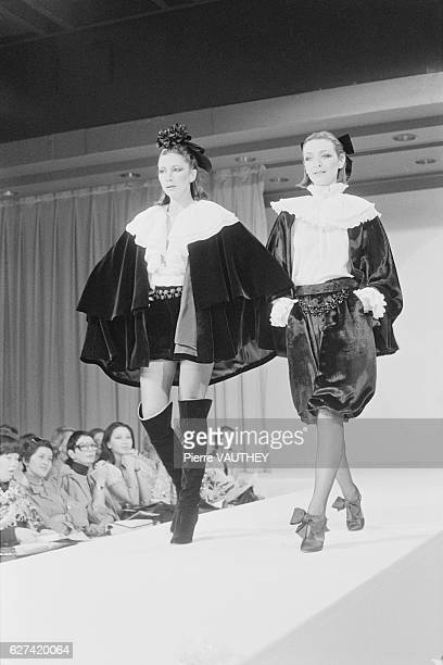 Two fashion models wear haute couture women's fashions by French designer Guy Laroche for his French fashion house during a 19771978 FallWinter...