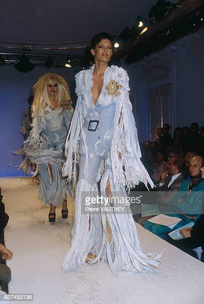 Two fashion models wear light blue readytowear evening gowns with fringe by German fashion designer Thierry Mugler They modeled the gowns during his...