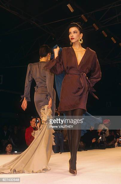 Two fashion models wear readytowear dresses by French fashion designer Emanuel Ungaro They modeled the dresses during his autumnwinter 19891990...