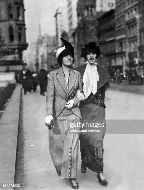 Two fashionable young women walking down a city street Washington DC circa 1913