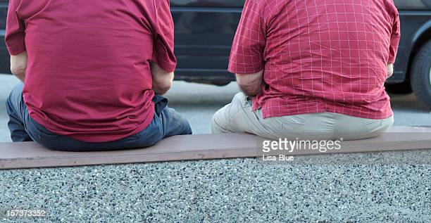 Two Fat Men Sitting on a Bench