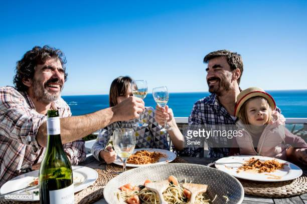 two fathers toasting at lunch - bolognese sauce stock pictures, royalty-free photos & images
