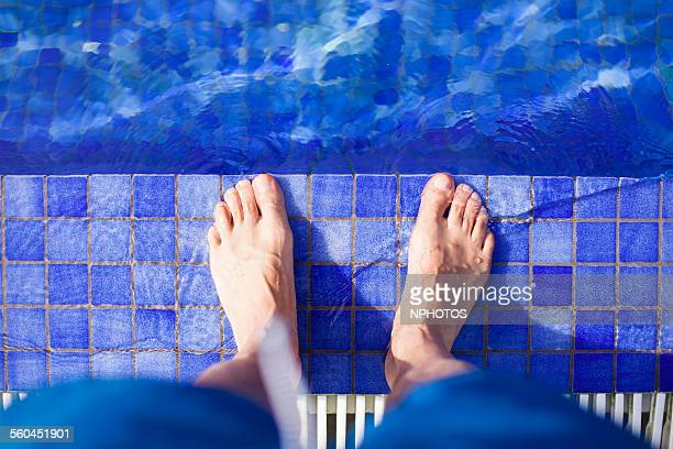 Two feet at border of pool
