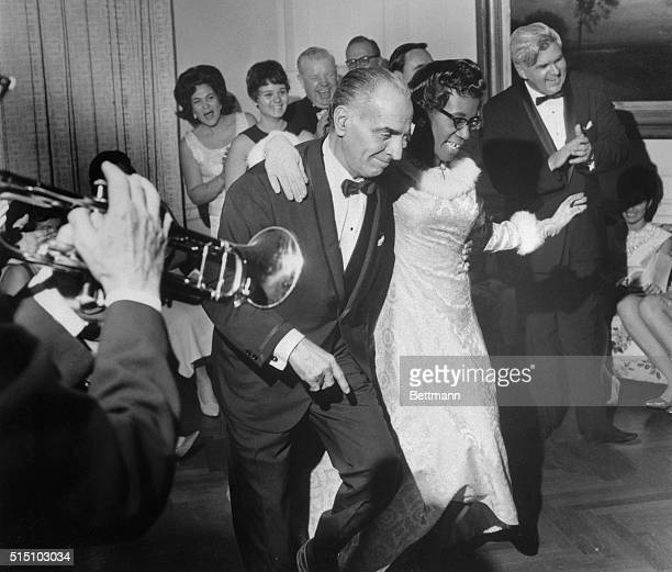 Two fellow Democrats Assembly Speaker Anthony J Travia and Assemblywoman Mrs Shirley Chisholm of Brooklyn get into the swing of things at Governor...