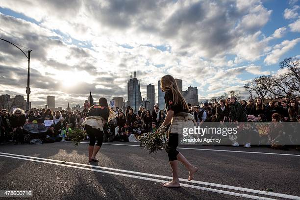 Two female Aboriginal dancers holding Gum leaves dance during a rally protesting against the forced closure of Aboriginal Communities in Australia on...