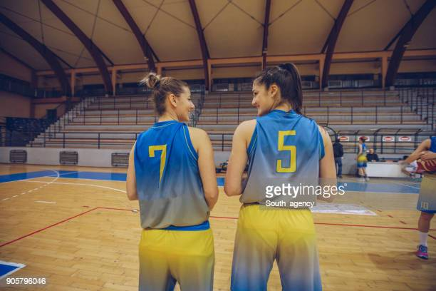 Two female basketball players