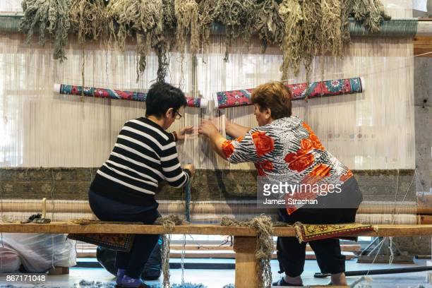 Two female carpet weavers at work, Yerevan, Armenia (two Model Releases and Property Release)