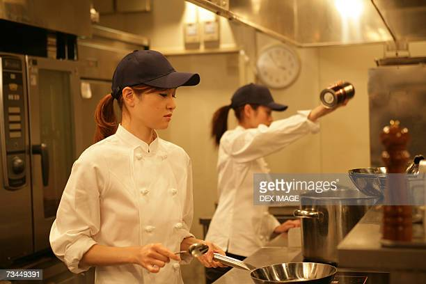 Two female chefs preparing food in the kitchen