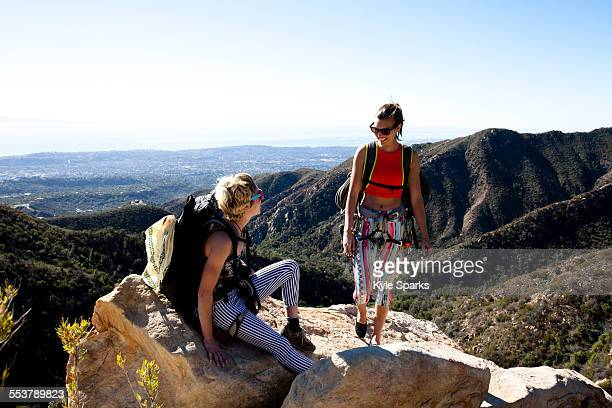 Two female climbers talk after climbing on Lower Gibraltar Rock in Santa Barbara, California.