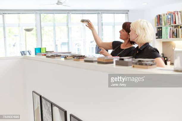 Two female designers looking at swatch in office