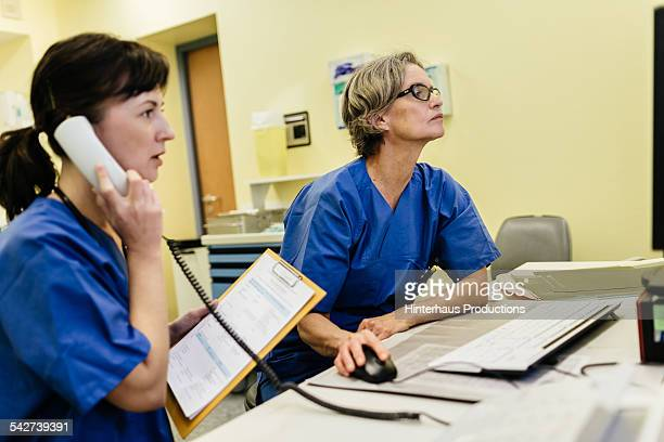 Two Female doctors at office desk