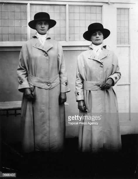 Two female doorkeepers with switches at Selfridges the London department store